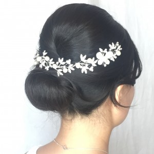 Brunette bride with flowers in hair